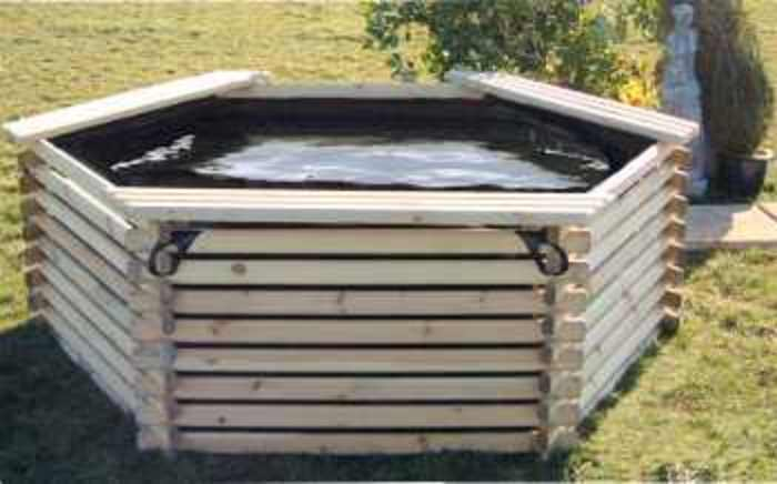 Barrel garden 600 gallon koi log pond for Wooden koi pond construction