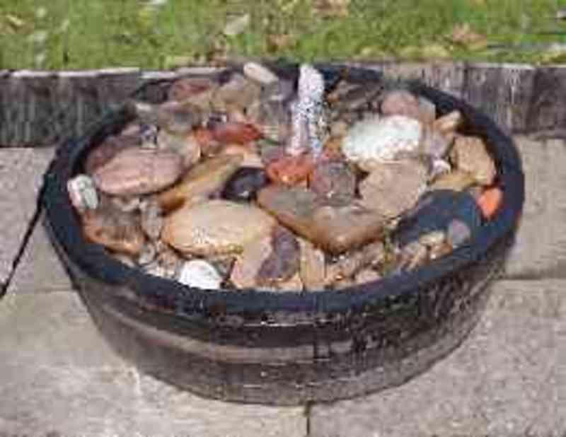 Barrel garden shallow water barrel peeble pool tub for Shallow koi pond